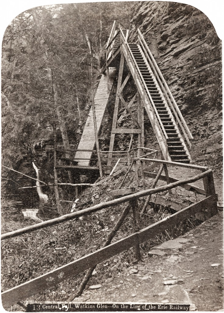 19th century photograph of a wooden staircase climbing to Central Cascade in Watkins Glen.