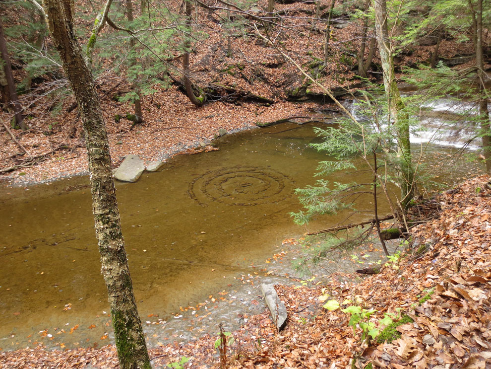 Stone spiral sculpture in the bed of Buttermilk Creek in Buttermilk Falls State Park, Ithaca, NY, Finger Lakes region