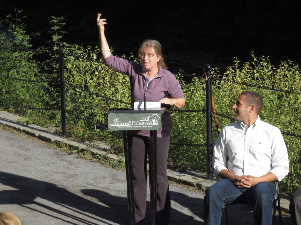 Ithaca Mayor Svante Myrick looks on as former Mayor Carolyn Peterson celebrates the long-awaited re-opening of the Cascadilla Gorge Trail between downtown and Collegetown.
